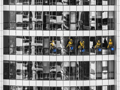 Five Men Cleaning High Level Building