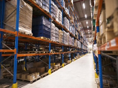 interior large distribution warehouse with shelves stacked with palettes goods ready market min